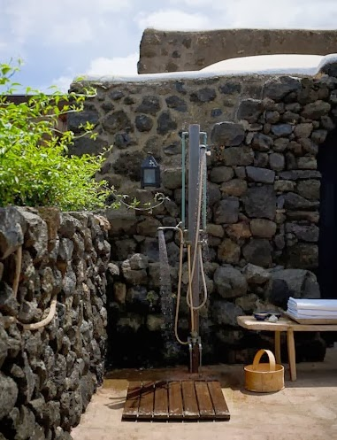 To da loos lava rock outdoor showers for Outdoor rock shower