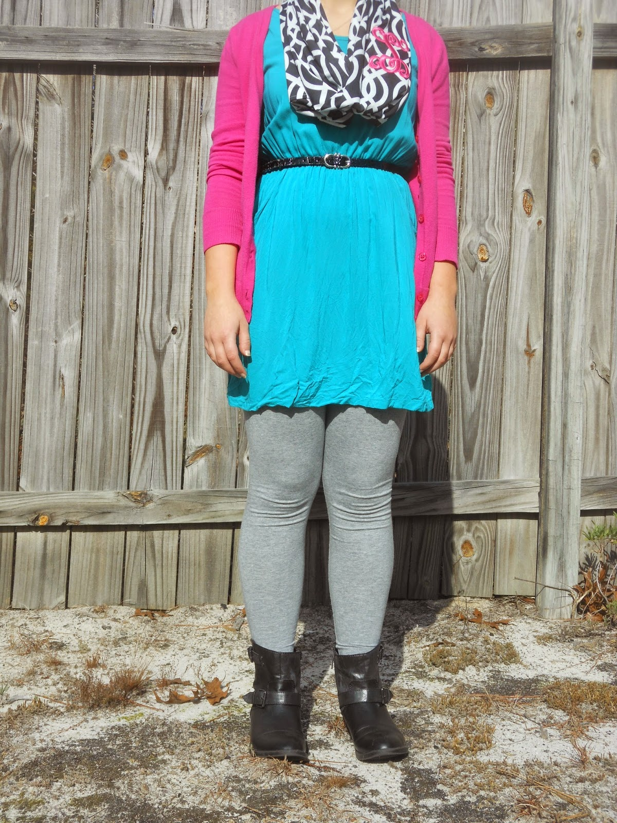 How to Wear a Dress in Winter    04. Teal tunic dress, grey leggings, pink cardigan, black ankle boots, black and white monogrammed scarf, black belt