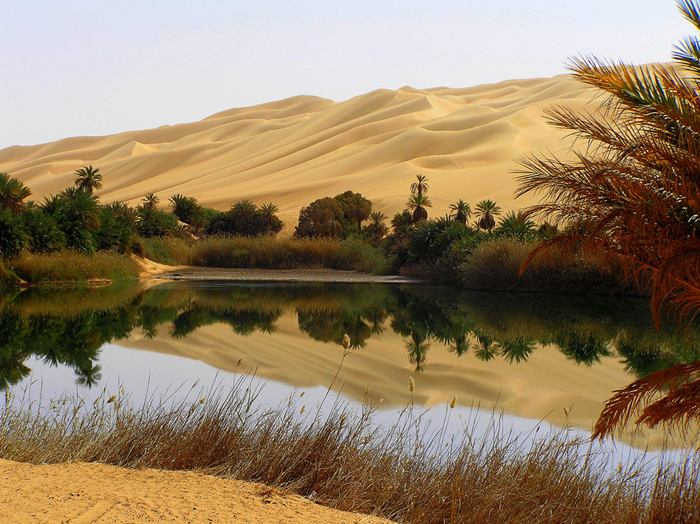 Ubari lakes were located in the southern regions of Wadi Irawan, Wadi al-Ajal and the Ubari Sand Sea. The archaeological finds from the area include dark layers of organic matters, shells, hand axes and other Palaeolithic and Neolithic implements and tools which strongly suggested ancient human activity in Fezzan. These lakes were part of a larger network of lakes which have included the legendary nearby Lake Tritonis and Lake Chad among numerous other smaller lakes