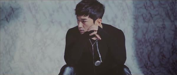 Shinhwa's Minwoo in the Sniper Music Video