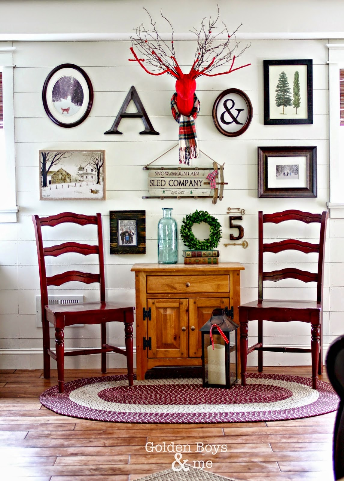 Winter theme planked gallery wall in rustic Christmas family room-www.goldenboysandme.com