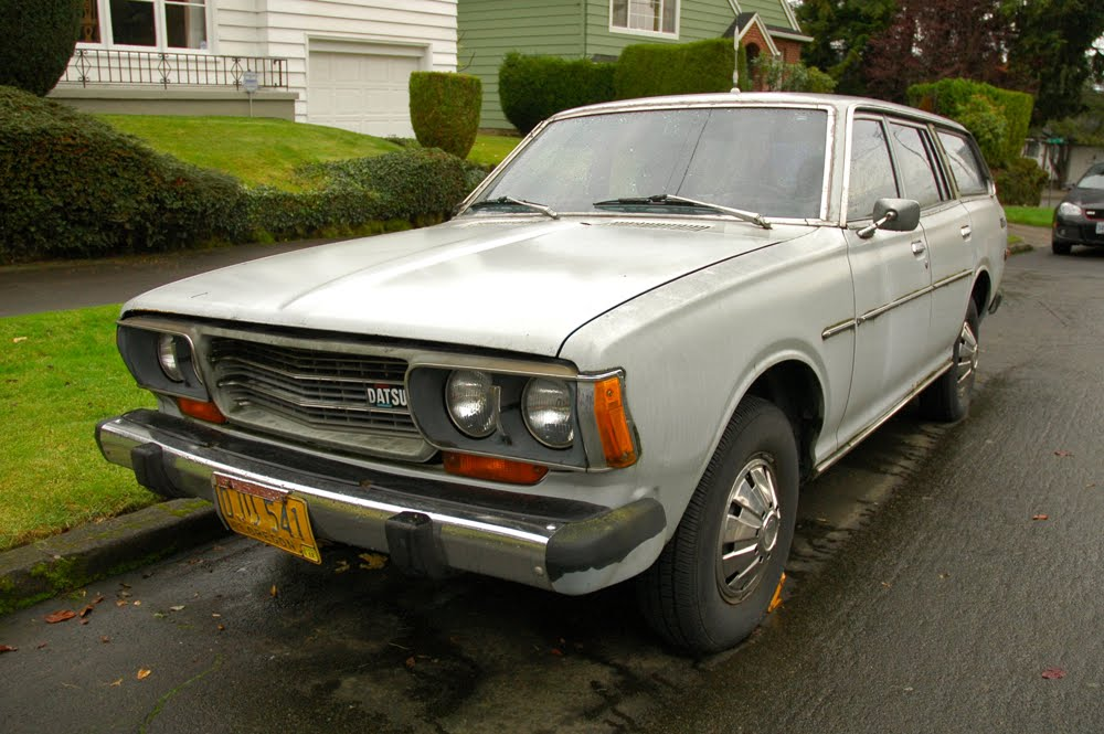 OLD PARKED CARS.: 1976 Datsun 610 wagon.