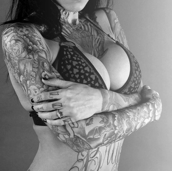 tattoo girl inked boobs