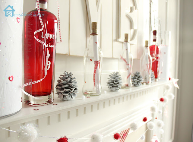 red and white valentine mantel with love potion #9 and message in a bottle