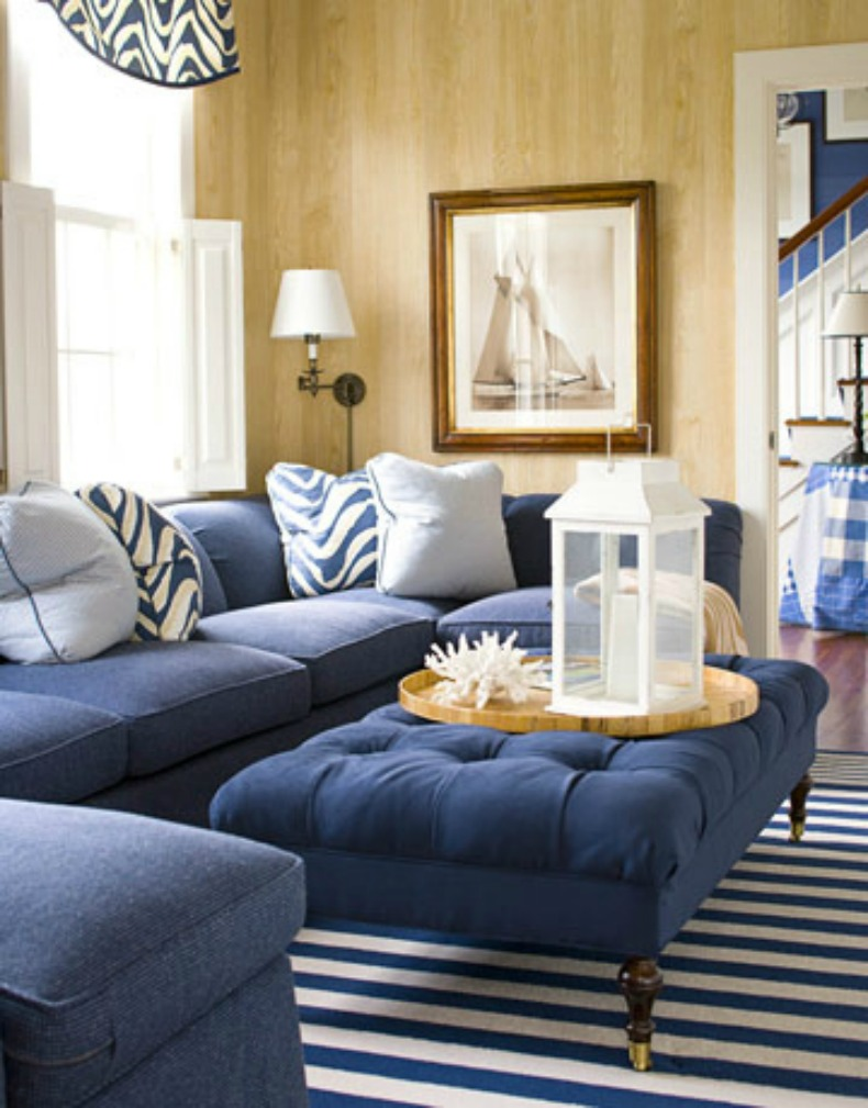 Navy and white coastal room with navy slipcover sectional