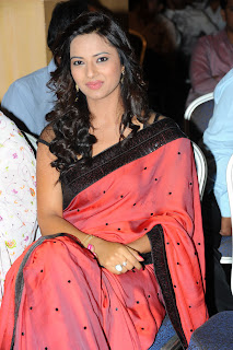 Isha Chawla looks cute and beautiful in red Saree at Poola Rangadu Audio Function