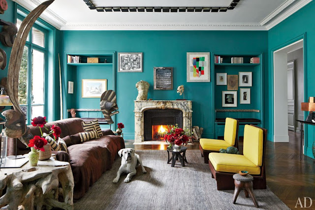 Living room in Stefano Pilati of Zegna's Paris duplex with turquoise walls and yellow Frank Lloyd Wright chairs