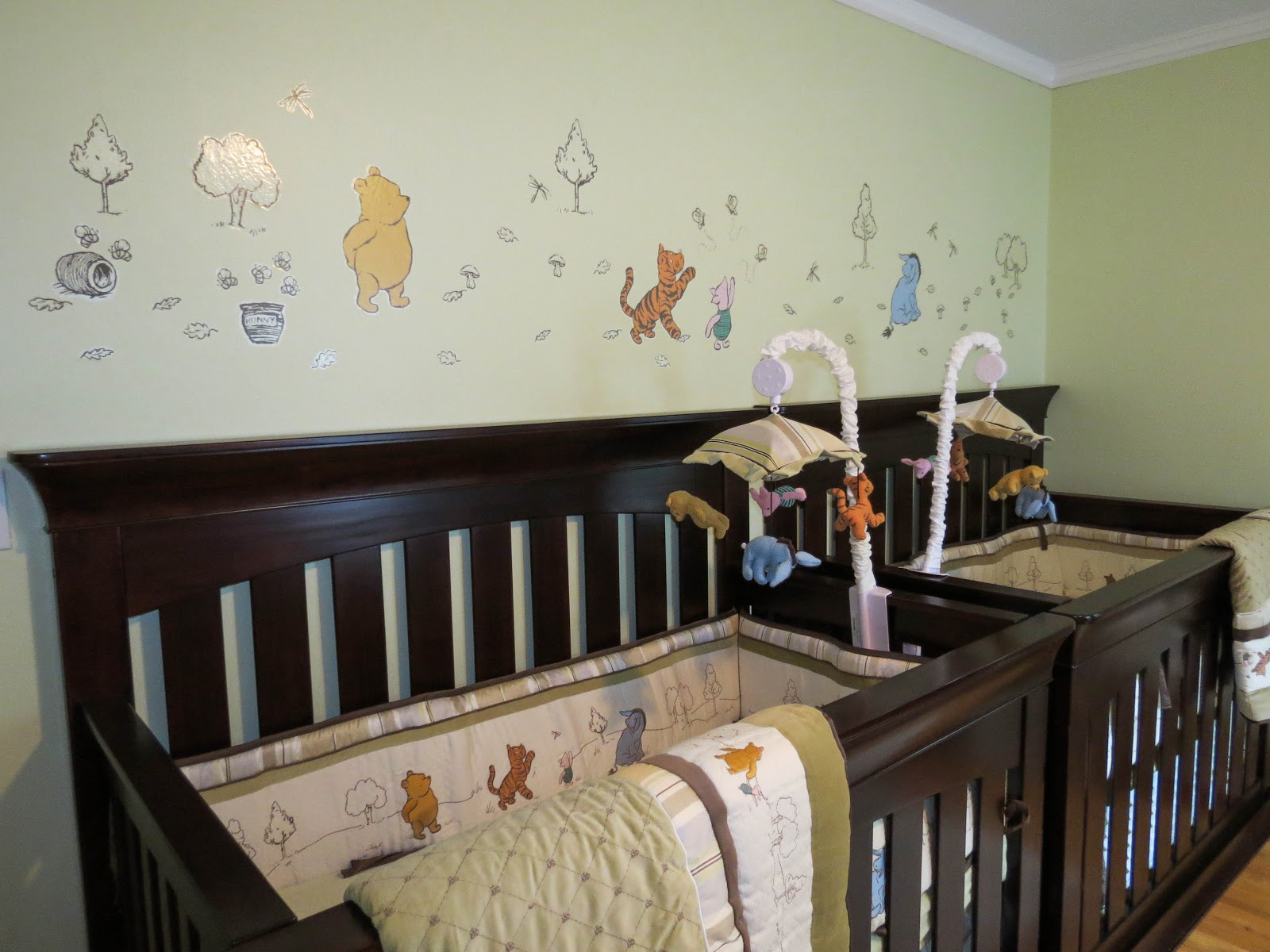 Share the wonder twin boy nursery in classic winnie the pooh for Baby cot decoration ideas