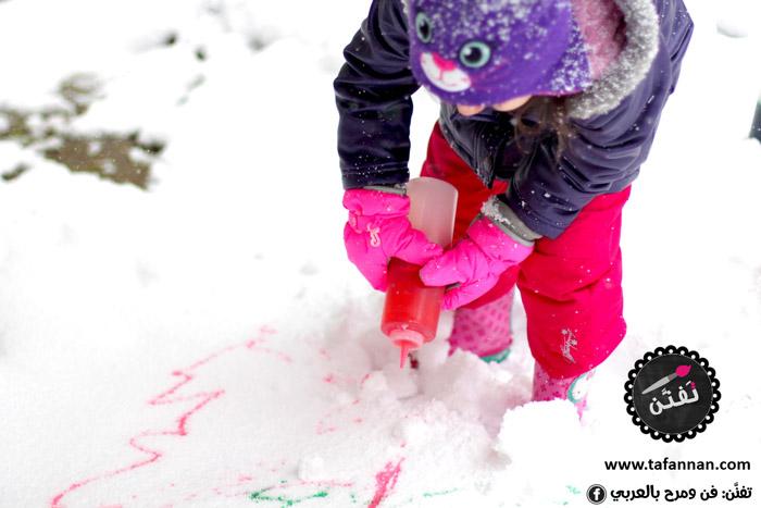 نشاط تلوين الثلج وختامها ثلج وألوان snow painting