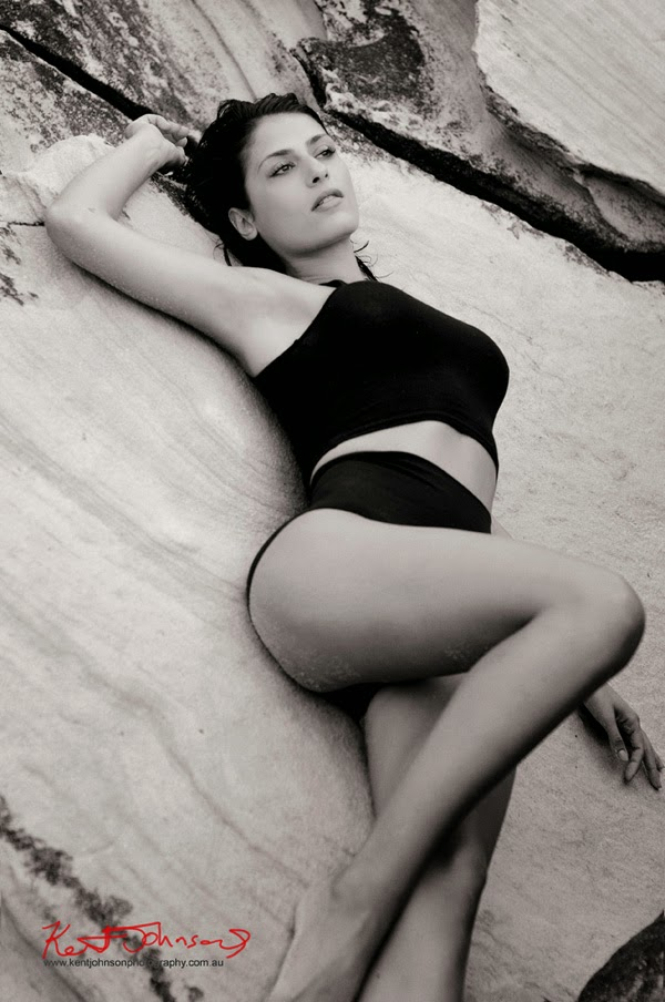 Monica, reclining on sandstone rock shelf, Sydney Harbour Fashion Portfolio beach shoot. Fine Art, Black and White Photography.