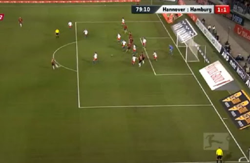 Hannover player Jan Schlaudraff unleashes an audacious volley to score against Hamburg
