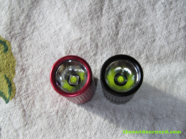 Olight I3S AAA flashlight - Closeup of emitters side by side with I3