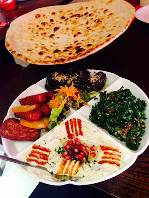 Mezze at Iranian restaurant Manoush in Bayswater: hummus, dolma, halloumi, baba ghanoush and tabbouleh