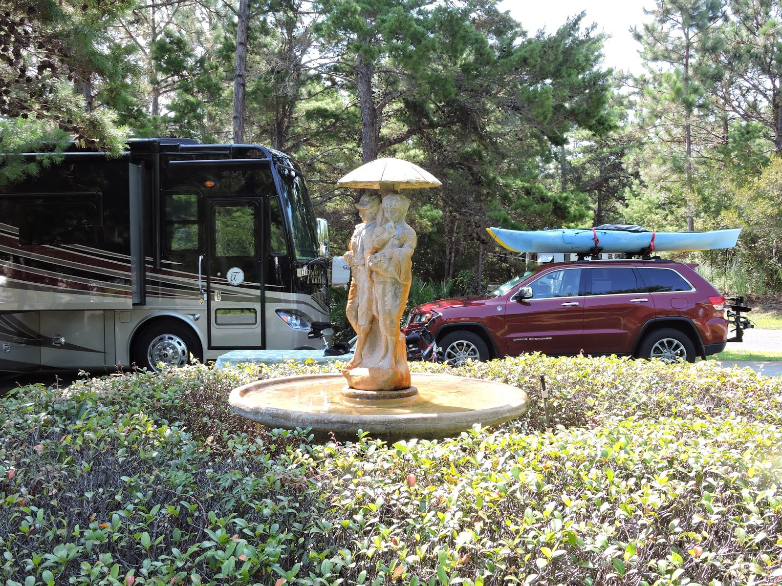 our site at the park was amazing shaded by pine trees all around us and our own little park area next to us with a bird bath and statue