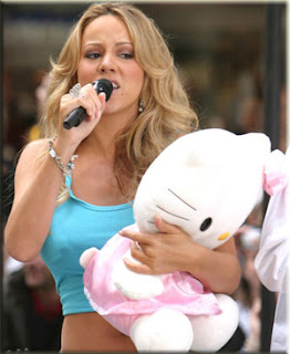 Mariah Carey singing and cuddling a cute Hello Kitty plush soft toy