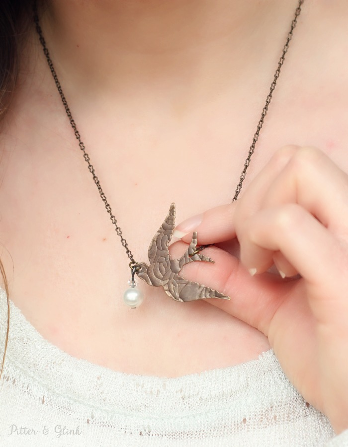 The Sizzix BIGkick machine is used to make a pretty Etched Metal Songbird Necklace. pitterandglink.com