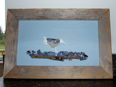 I made this picture using shells and driftwood I found on the beach this summer.