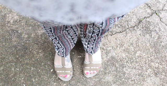patterned trousers and brown sandals