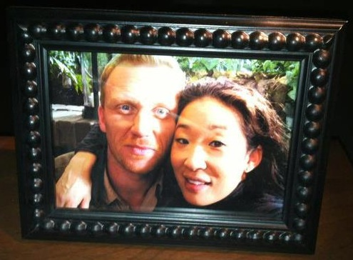 sandra oh and kevin mckidd as cristina yang and owen hunt on grey's anatomy set