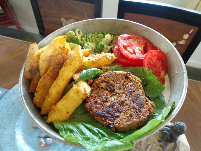 sprouted raw vegan or vegan black bean burgers with jicama fries, avocado and tomatoes
