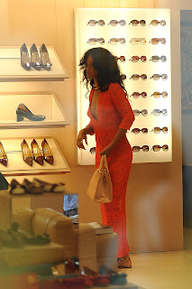 Rihanna looking at shoes