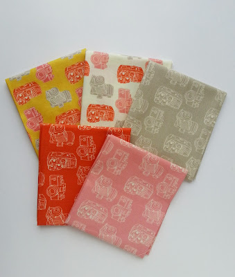 folded fabric with a camera motif in 5 different colors