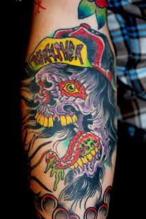 Tattoo of a purple skull head with Thrasher hat by tattoo artist Jason Kunz for Triumph Tattoo