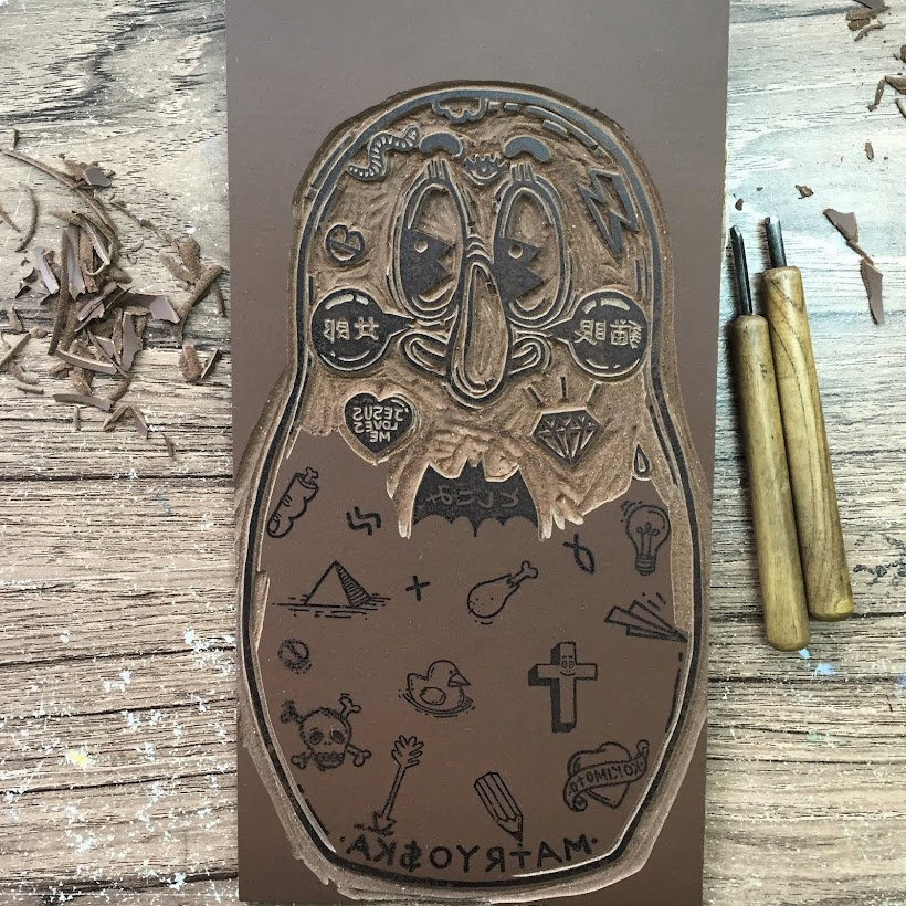 Carving a lino block for MATRYO$KA Linocut Edition