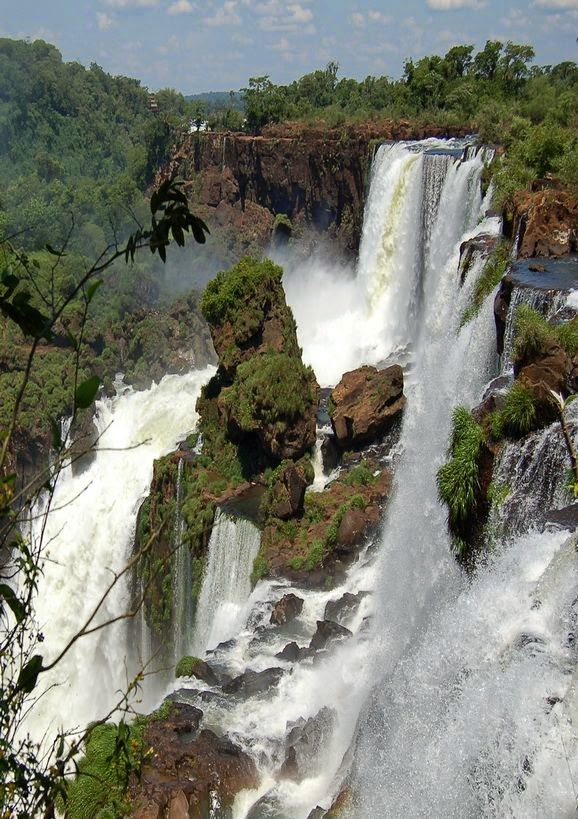 The Iguazu Waterfalls, Argentina-Brazil Border Heralded as the most beautiful waterfalls in the world, the Iguazu Waterfalls are a true wonder of nature. They are located at the border of Argentina, Brazil, and Paraguay