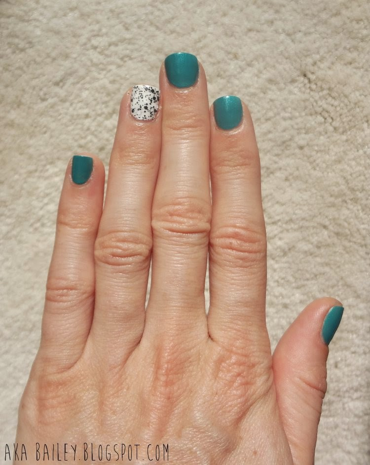 Turquoise polish with black and white polka dot accent nail