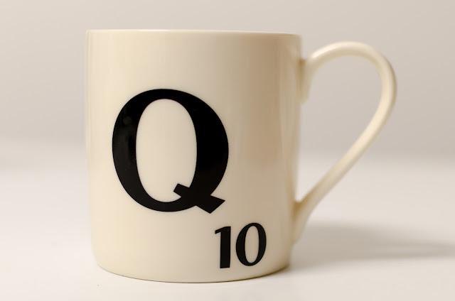 scrabble mug with the letter q written on it
