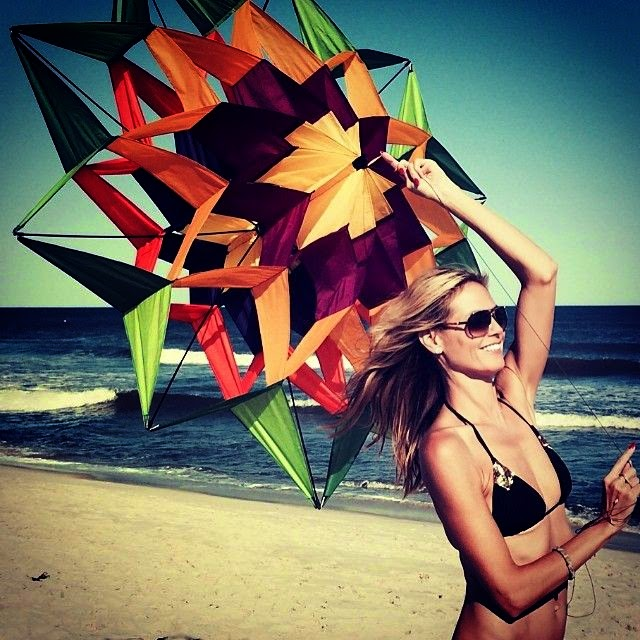 the 40-year-old kept it up this weekend with some more bikini anatomy photos from her time to playing a wonderful of colorful kite in Los Angeles on Saturday, July 5, 2014.