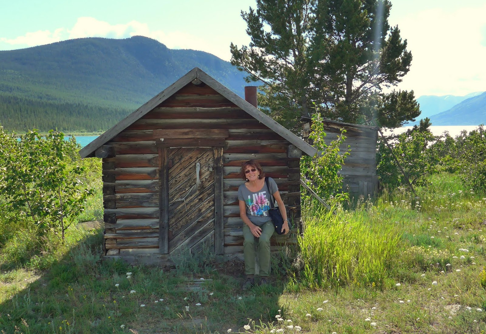 Liz having a rest in front of a storage cabin.