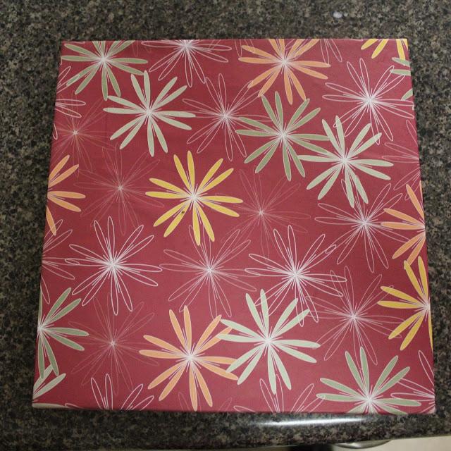 scrapbook paper, 10x10 canvas, modpodge, bathroom art