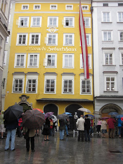 Mozart's birthplace would not stand out among the other 15th century buildings unless it was painted yellow  be