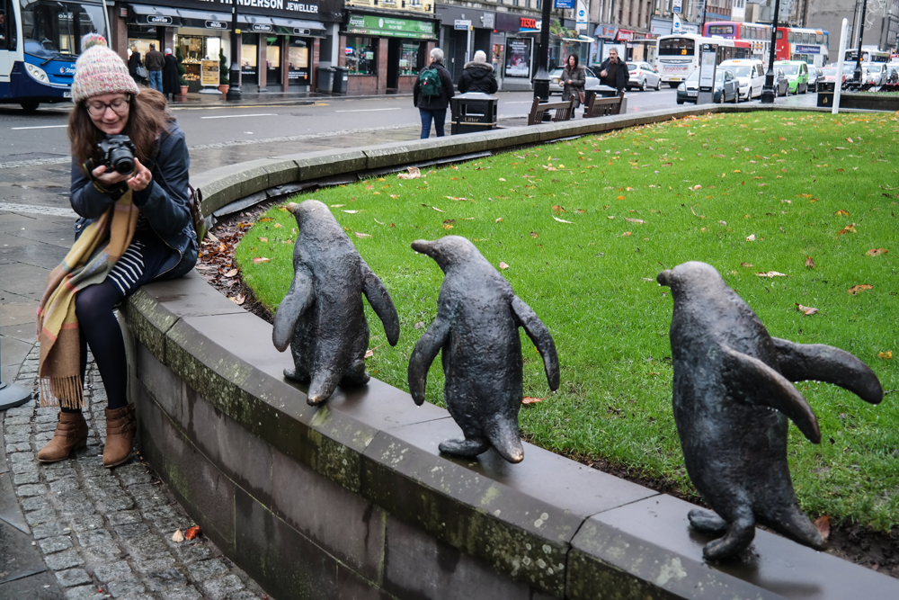 Elise photographing penguin statues