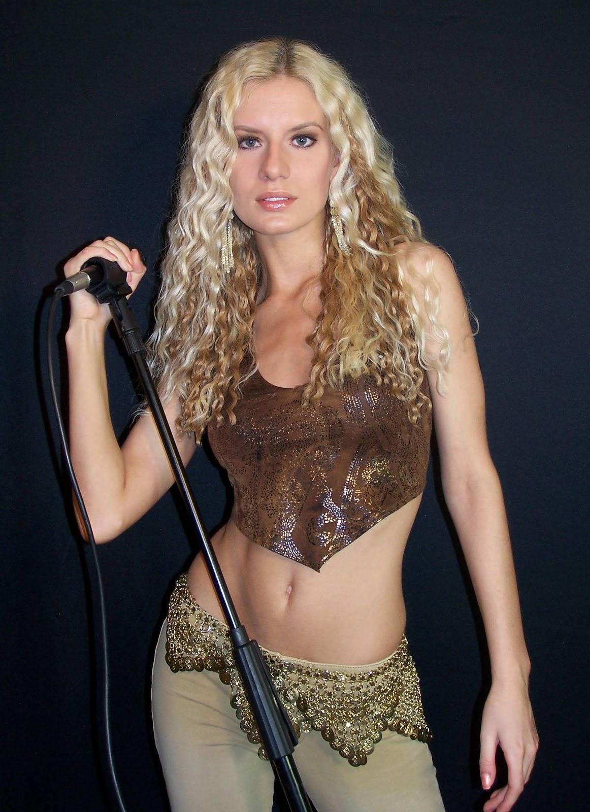 http://4.bp.blogspot.com/-Rycc1f4uYgg/TrNhpsjxRpI/AAAAAAAADNM/o_ju8clipis/s1600/Shakira_5.jpg