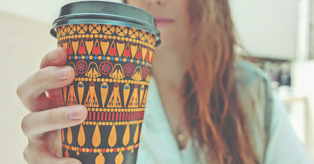 Girl holding a coffee cup