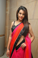 Deeksha Panth in Lovely Red Saree Black Sleeveless Blouse Young Beauty Stunning Pics