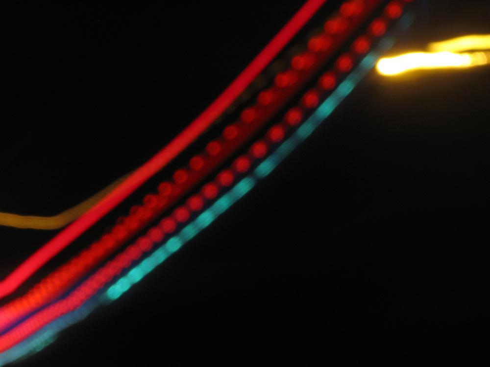 camera shake, car and truck lights on the freeway (c) David Ocker