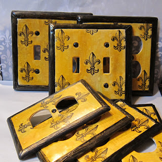 These are custom fleur-de-lis light switch plate covers by Marie Young Creative