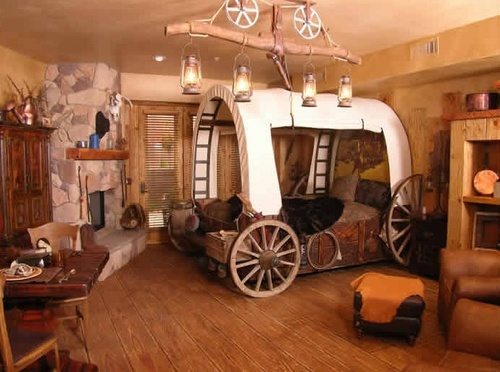 Creative world themed hotel rooms for Cowboy themed bedroom ideas