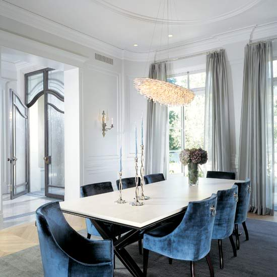 blue dining room decor velvet chairs white walls long windows curtain