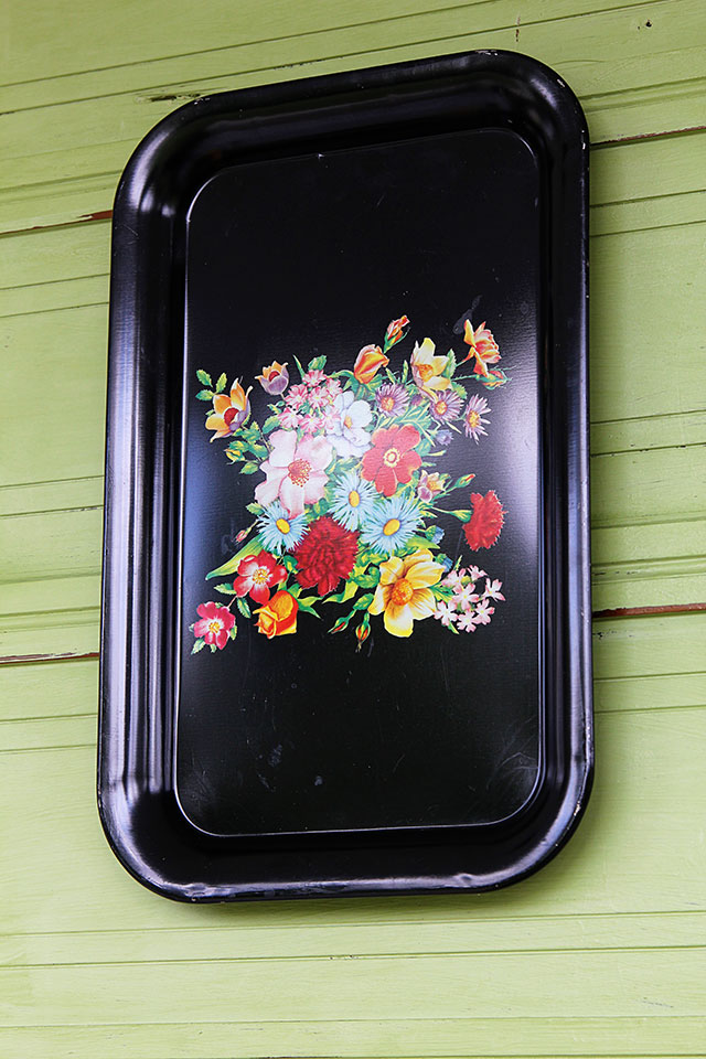 Black tray as part of vintage spring front porch decor
