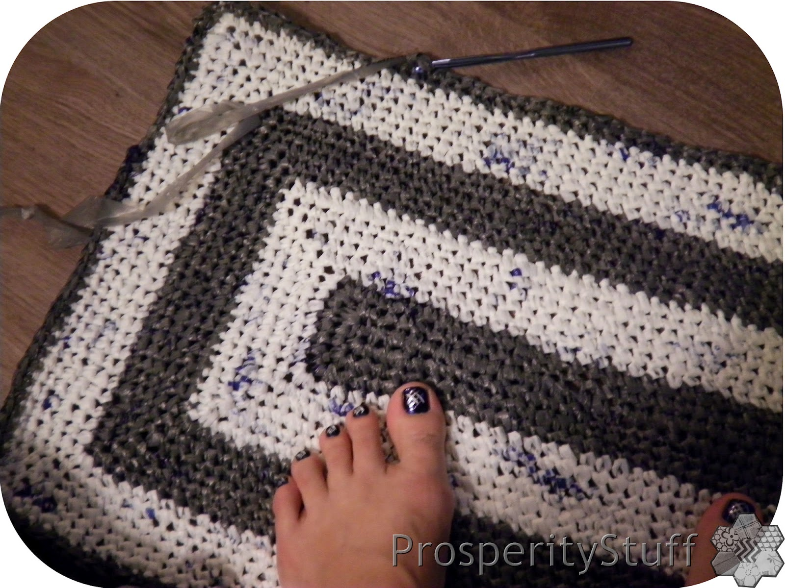 Plarn crochet rug - made from gray and white Wal-mart bags