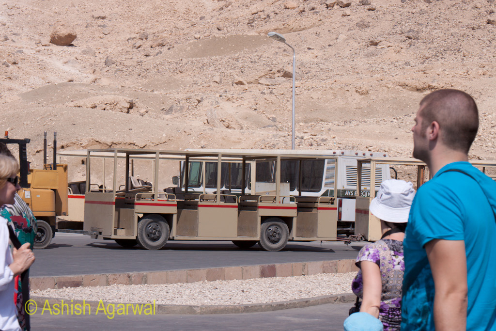 Tourists getting off from the battery operated buses that take them near the Hatshepsut mortuary temple