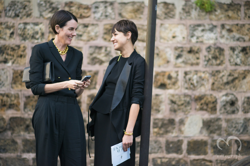 Two women talk on the street after Maison Martin Margiela 2015 Spring Summer show during Paris Fashion Week PFW