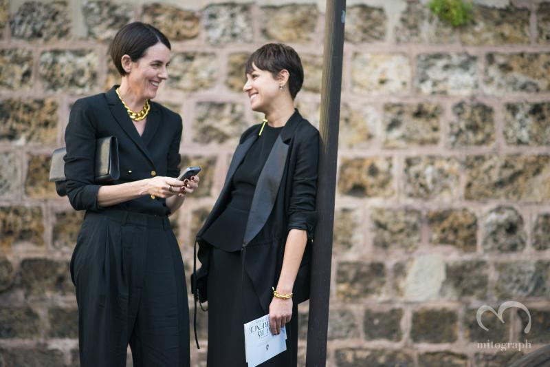 Two women talk on the street after Maison Martin Margiela 2015 Spring Summer show during Paris Fashion Week PFW