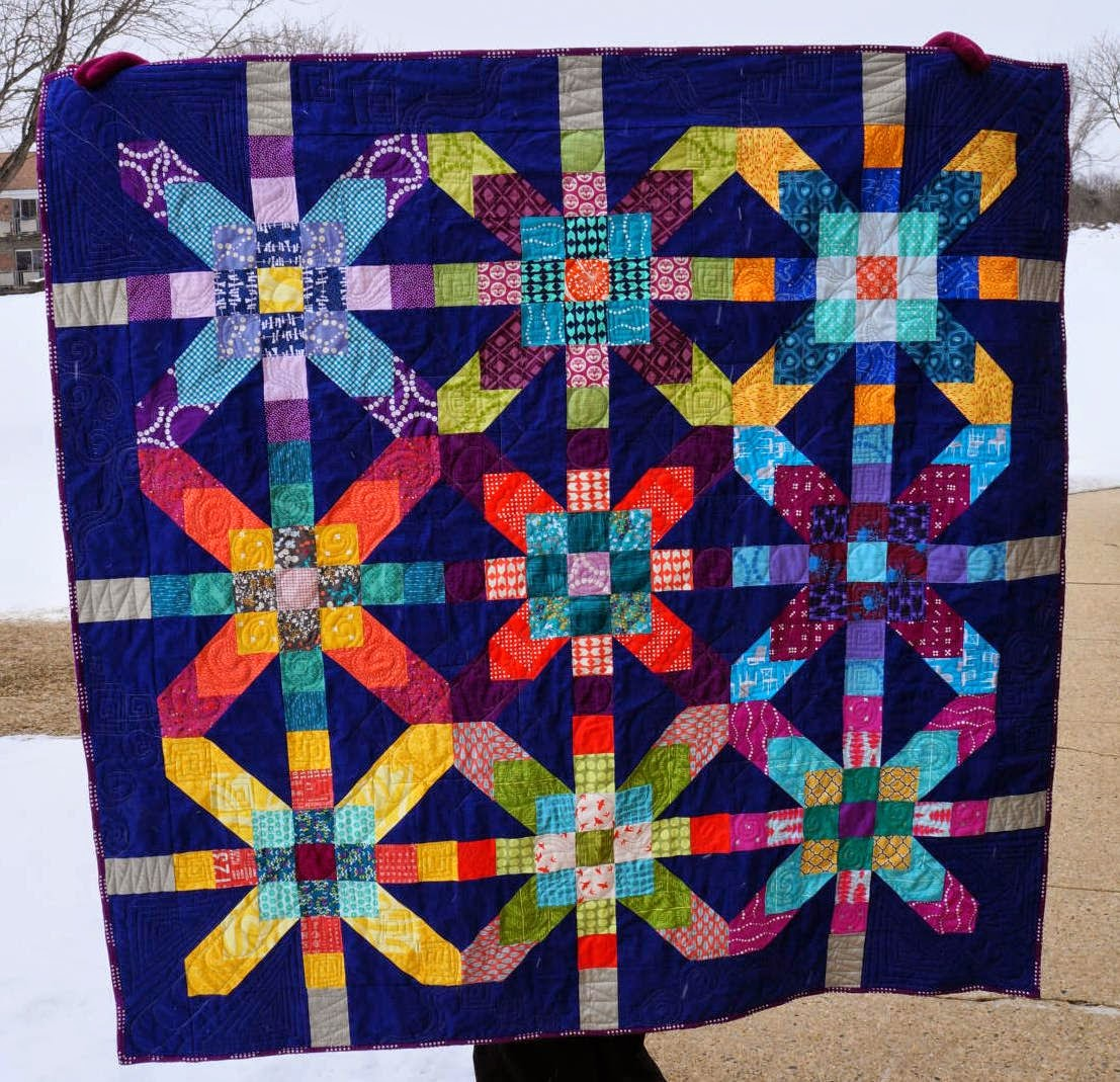 http://quiltyhabit.blogspot.com/2015/02/supernova-in-blue-finished-quilt.html