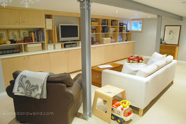 clean_bright_white_basement_renovation_built_in_shelves